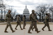 Members of the National Guard patrol near the US Capitol building ahead of President-elect Joe Biden's inauguration [Andrew Kelly/Reuters]