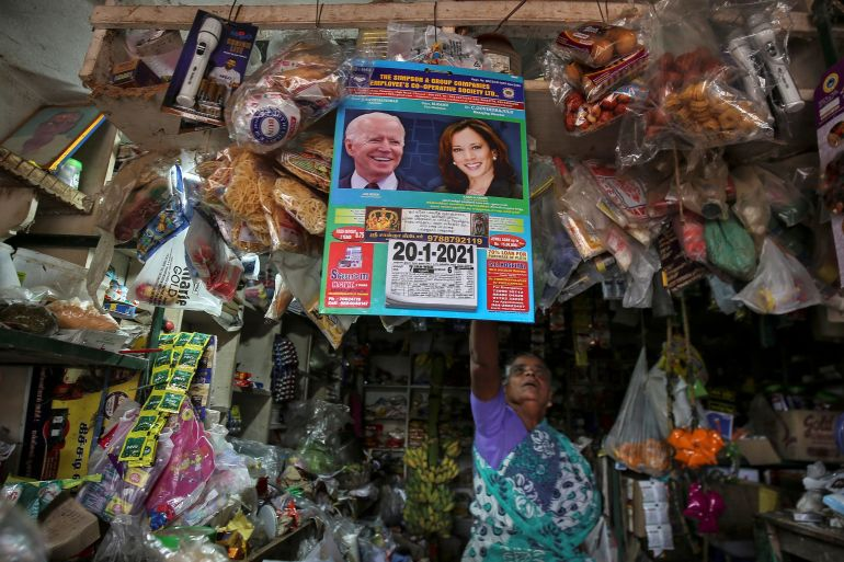 A calendar with photos of Biden and Harris hangs in a shop in Thulasendrapuram village in Tamil Nadu state [P Ravikumar/Reuters]