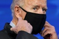 President Joe Biden's first moves are intended to mark a sharp change from the Trump administration's pandemic response [Kevin Lamarque/Reuters]