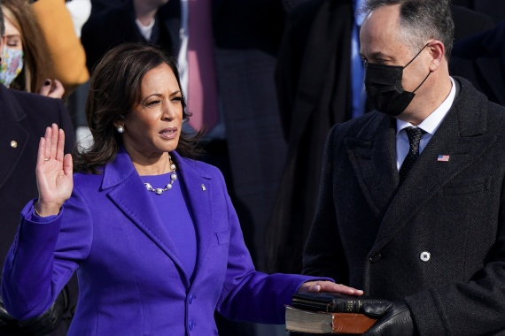 Kamala Harris is sworn in as US vice president as her spouse Doug Emhoff holds a Bible during the inauguration ceremony on the West Front of the US Capitol. [Kevin Lamarque/Reuters]