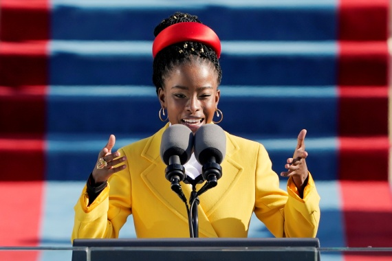 American poet Amanda Gorman reads a poem during the 59th Presidential Inauguration at the US Capitol in Washington. [Patrick Semansky/Pool/Reuters]