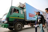A pickup van carries AstraZeneca vaccines, which arrived from India as a gift to Bangladesh, from the Hazrat Shahjalal International Airport to the storage house, in Dhaka [Mohammad Ponir Hossain/Reuters]