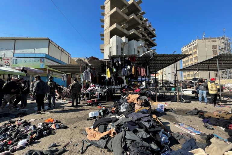 The site of the suicide bomb attack in a central market [Thaier al-Sudani/Reuters]