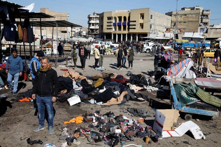 The site of a twin suicide bombing attack in a central market is seen in Baghdad, Iraq January 21, 2021 [Thaier al-Sudani/Reuters]