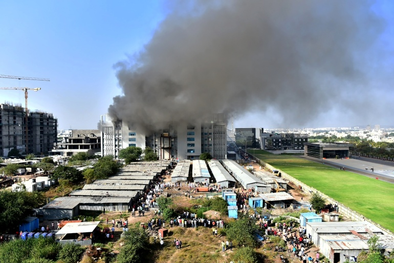 Smoke rises from Serum Institute of India plant in Pune, India [Reuters]