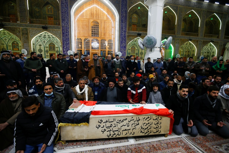 Mourners gather near the coffin of a man, who was killed in a twin suicide bombing attack in a central Baghdad market, during a funeral in Najaf, Iraq [Alaa Al-Marjani/Reuters]