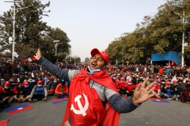 A protester affiliated with a faction of the ruling Nepal Communist Party dances as he takes part in a protest against the dissolution of Parliament, in Kathmandu [File: Navesh Chitrakar/Reuters]
