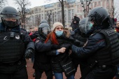 Police arrested a few people gathered in Moscow before the rally [Maxim Shemetov/Reuters]