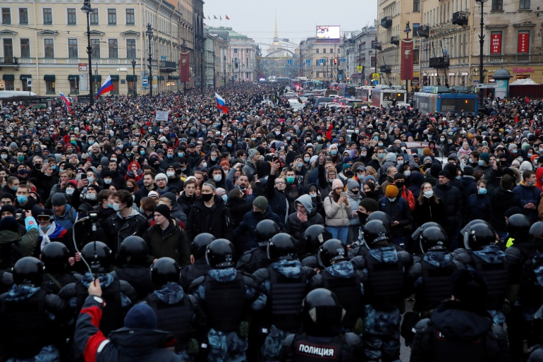 Police officers stand in front of protesters in Saint Petersburg, Russia [Anton Vaganov/Reuters]