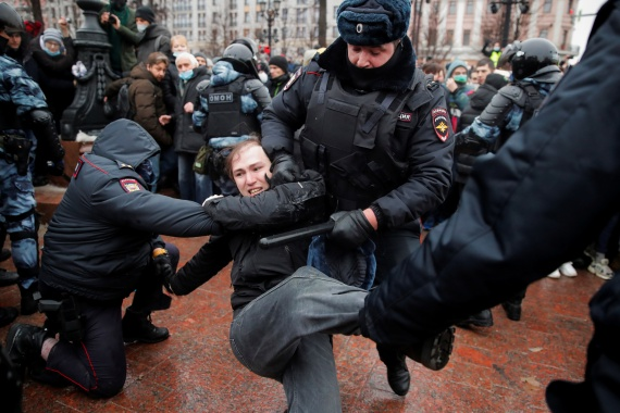 Law enforcement officers detain a man during the rally in the Russian capital. [Maxim Shemetov/Reuters]