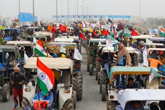 Farmers participate in an earlier 'tractor rally' on a highway on the outskirts of New Delhi [File: Adnan Abidi/Reuters]