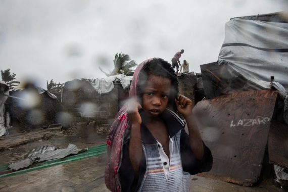 Residents of Beira's Praia Nova neighbourhood seek shelter from Tropical Cyclone Eloise. Eloise is the second cyclone to hit central Mozambique this season, after Chalane in December. [UNICEF/Handout via Reuters]