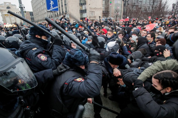 Law enforcement officers clash with participants during a rally in support of jailed Russian opposition leader Alexey Navalny in Moscow [Maxim Shemetov/Reuters]
