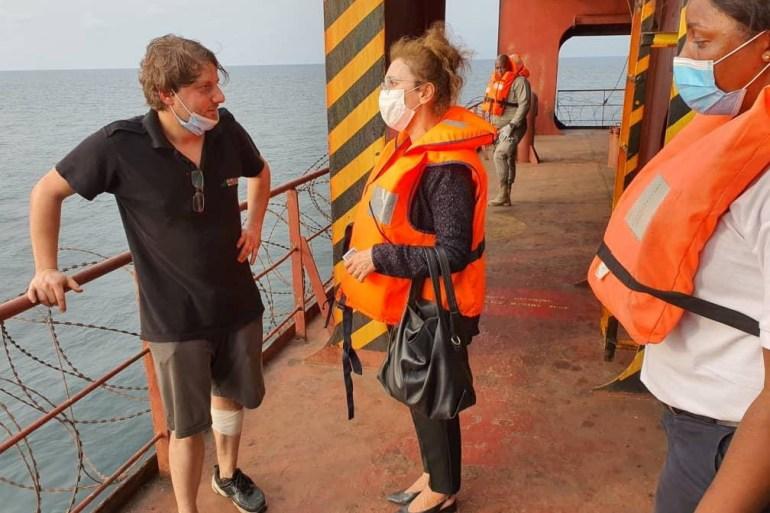 Turkish ambassador to Libreville, Nilufer Erdem Kaygisiz, centre, meets Turkish sailors on board the attacked container ship MV Mozart in Port-Gentil, Gabon [Turkish Embassy in Libreville/via Reuters]