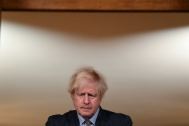 Britain's Prime Minister Boris Johnson said he was 'deeply sorry' as the death toll in the UK surpassed 100,000 [Justin Tallis/Pool via Reuters]