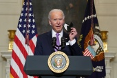 US President Joe Biden urged Americans to continue wearing masks as the country rolls out vaccines in greater numbers to contain the COVID-19 pandemic [Kevin Lamarque/Reuters]