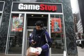 GameStop, a struggling US video game retailer, has seen its share price surge from below $3 in April 2020 to more than $373 on Wednesday [File: Carlo Allegri/Reuters]