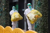 Members of a WHO team tasked with investigating the origins of the coronavirus (COVID-19) pandemic are due to leave quarantine in Wuhan on Thursday [Thomas Peter/Reuters]