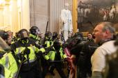 Police clash with US President Donald Trump's supporters who breached security and entered the Capitol building in Washington, DC, on January 6, 2021 [Mostafa Bassim/Anadolu]