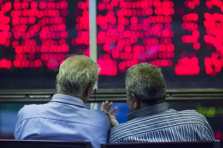 In August, the Tehran Stock Exchange's benchmark index, TEDPIX, surged past two million points - and then the bubble burst [File: Simon Dawson/Bloomberg]