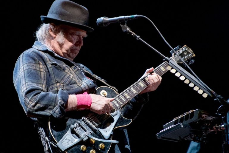 Hipgnosis Songs Fund Ltd bought half of the copyright and income interests for Canadian singer Neil Young's 1,180 songs, including many of his biggest hits [File: Alice Chiche/AFP/Getty Images]
