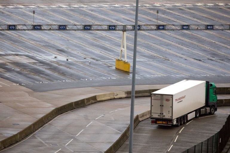 Goods traffic at the port of Dover near the UK's southern crossing to France is down sharply from year-ago levels, but many trucks are stuck at factories and depots as they try to resolve bureaucratic issues due to Brexit [File: Chris Ratcliffe/Bloomberg]