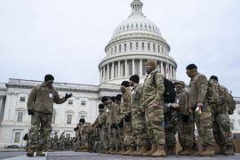 Members of the National Guard stand outside of the US Capitol building in Washington, DC [Sarah Silbiger/Bloomberg]
