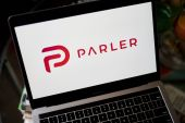 Parler's CEO says the return of the platform, which is favoured by far-right conspiracy theorists, was 'inevitable' [File: Gabby Jones/Bloomberg]
