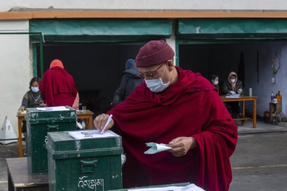 Exiled Tibetans vote in the first round to elect a new political leader and members of the Tibetan parliament in exile [Ashwini Bhatia/AP Photo]