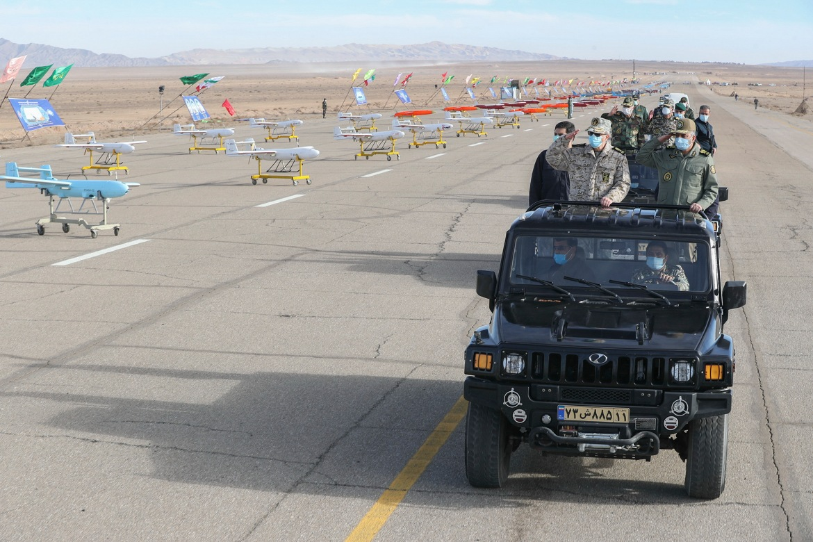 Chief of staff of Iran's armed forces, Mohammad Bagheri, leads a convoy of military officials in a ceremony to mark two days of military drone drills. [Courtesy of the Iranian government]