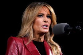 Melania Trump says she is 'disappointed and disheartened' by the deadly riot at the Capitol last week by supporters of her husband [Evan Vucci/AP Photo]