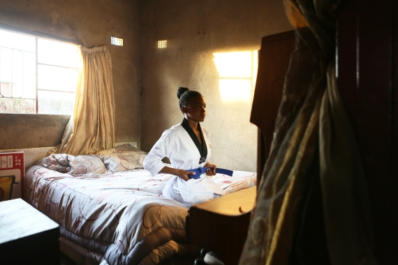 Natsiraishe Maritsa inside her room in the Epworth settlement near Harare [Tsvangirayi Mukwazhi/AP]