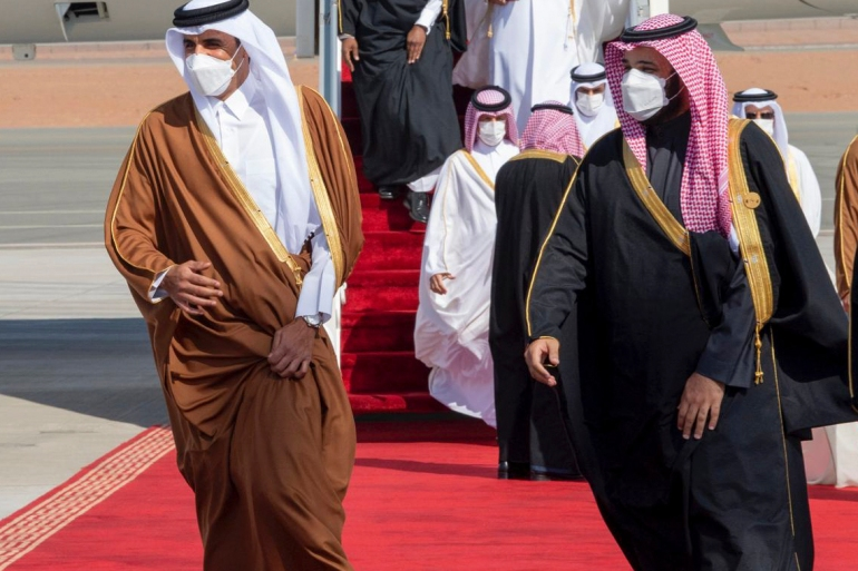 Saudi Arabia's Crown Prince Mohammed bin Salman (R) welcomes Qatar's Emir Sheikh Tamim bin Hamad al-Thani upon his arrival to attend the Gulf Cooperation Council's 41st Summit in Al-Ula, Saudi Arabia [Handout via AP]
