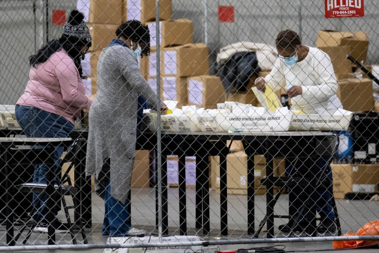 Election workers in Fulton County, Georgia process absentee ballots for the United States Senate runoff election in Georgia [Ben Gray/AP]