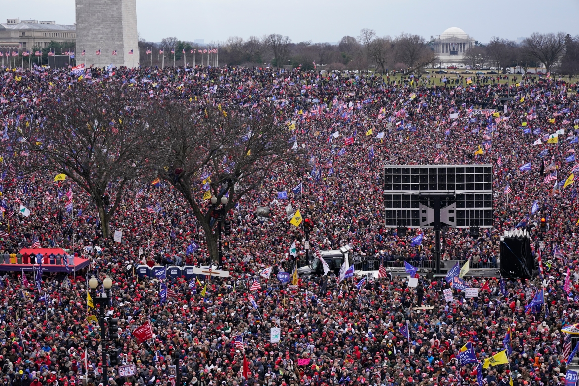 People attend a rally in support of President Donald Trump. [Jacquelyn Martin/AP Photo]