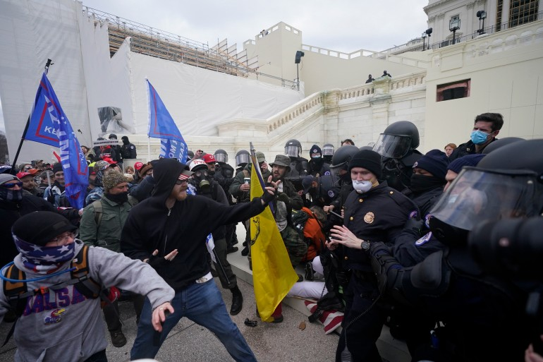 Trump supporters try to break through a police barrier, on January 6, 2021, at the Capitol in Washington [Julio Cortez/AP Photo]