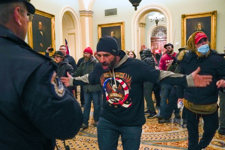 Hundreds of supporters of US President Donald Trump stormed the Capitol in Washington, DC, hoping to overturn his election defeat [File: Manuel Balce Ceneta/AP]
