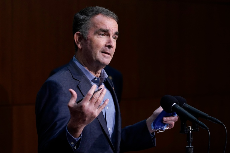 Virginia Governor Ralph Northam gestures during a COVID-19 briefing at the Capitol in Richmond, Virginia on November 18, 2020 [File: Steve Helber/AP Photo]