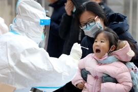 China has taken tough measures - including lockdowns and mass testing - to try and stamp out new outbreaks of COVID-19 [Liang Zidong/Xinhua via AP Photo]