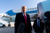 President Donald Trump speaks with reporters as he walks to Air Force One upon departure on Tuesday, January 12 at Andrews Air Force Base [File/Alex Brandon/AP] (AP Photo)