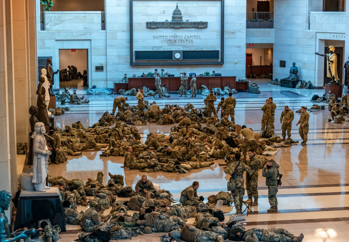 Hundreds of National Guard troops hold inside the Capitol Visitor's Center to reinforce security at the Capitol in Washington. [J. Scott Applewhite/AP Photo]