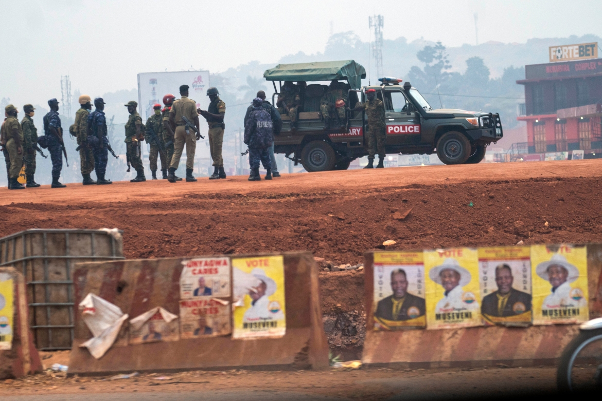 Security forces gather in Kampala. Museveni remains the frontrunner to win with the well-equipped army and police behind him, analysts say. [Jerome Delay/AP Photo]