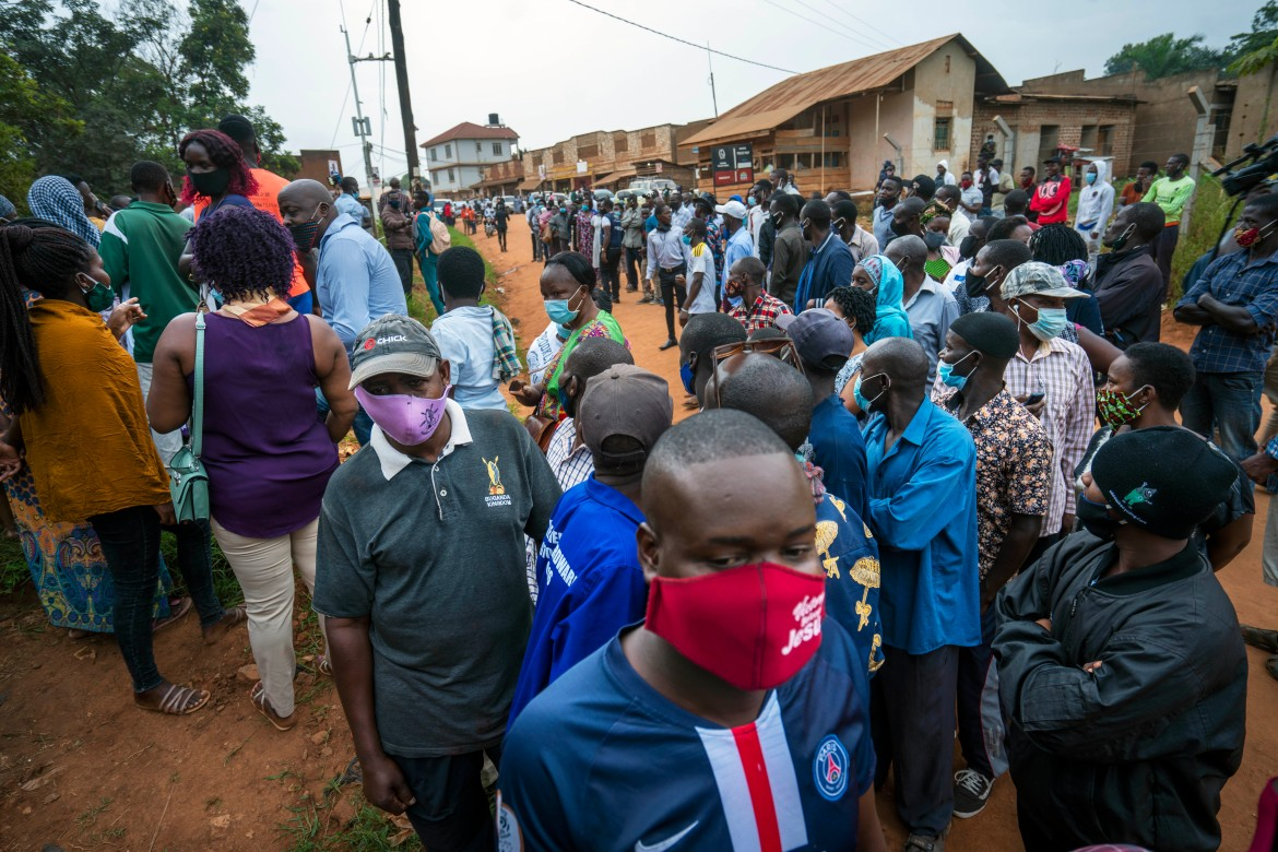 Ugandans are voting in a presidential election tainted by widespread violence that some fear could escalate as security forces try to stop supporters of leading opposition challenger Bobi Wine from monitoring polling stations. [Jerome Delay/AP Photo]