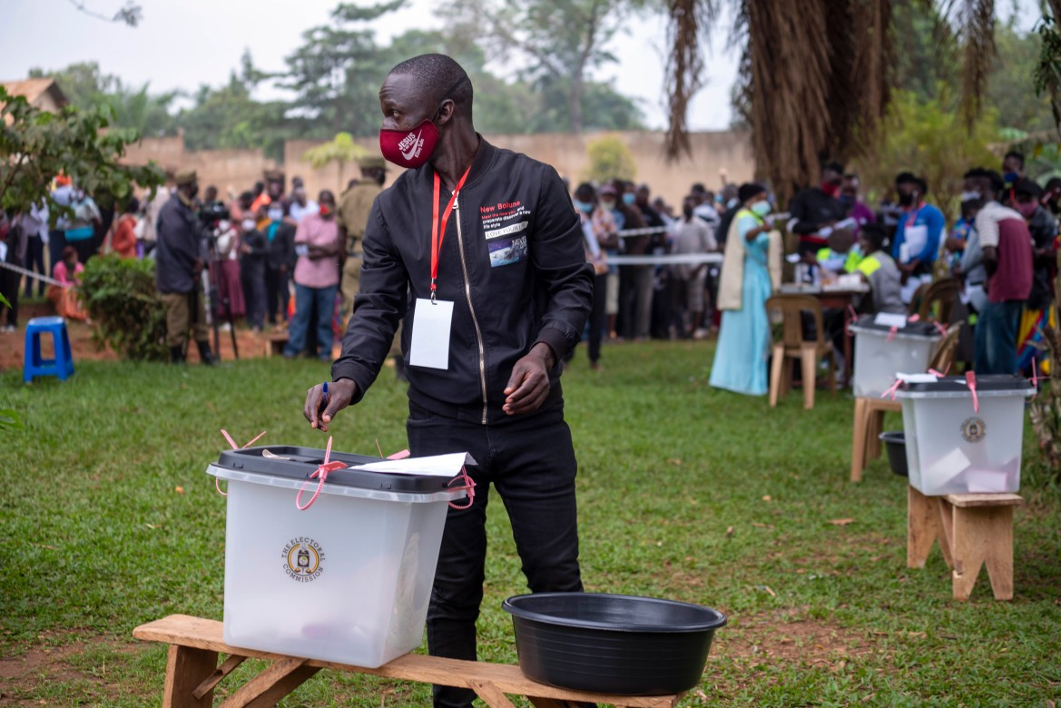Bobi Wine has urged supporters to linger near polling stations to protect their votes. But the electoral commission, which the opposition sees as weak, has said voters must return home after casting ballots. [Jerome Delay/AP Photo]