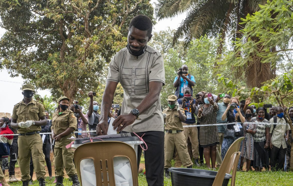 Uganda's leading opposition challenger Bobi Wine votes at a polling station in Kampala. [Jerome Delay/AP Photo]