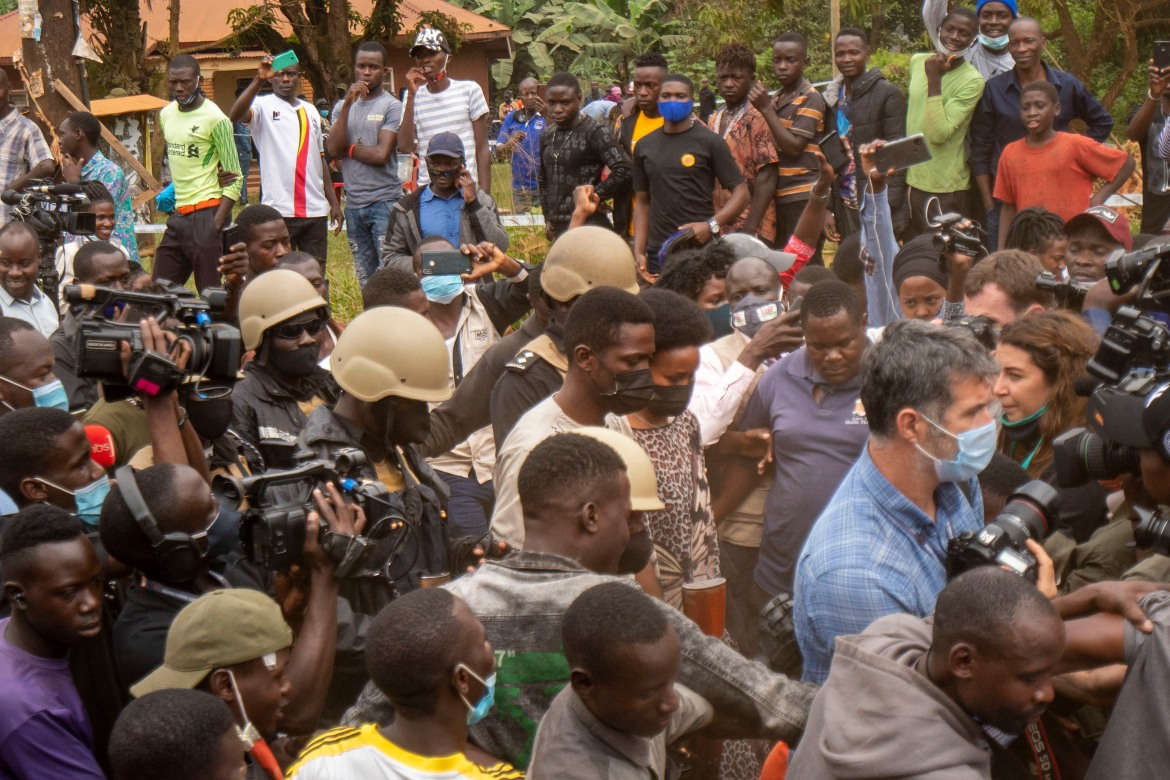 'In 22 districts, our teams are on the run because they are being surrounded and pursued by police and soldiers as if they are criminals,' Bobi Wine said. [Jerome Delay/AP Photo]