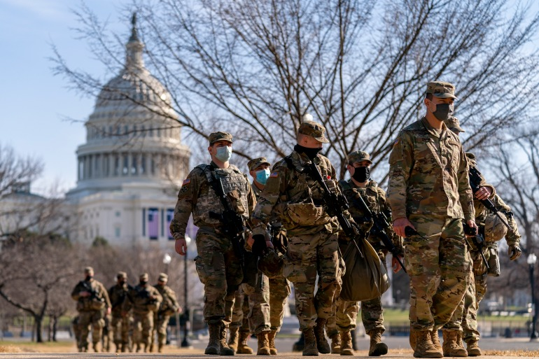 Members of the National Guard patrol outside the Capitol Building in Washington, DC [File: Andrew Harnik/AP Photo]