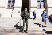 A Georgia State Patrol SWAT team member stands guard outside the Georgia State Capitol building [John Bazemore/AP Photo]