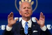 Biden's winning campaign was backed by $145 million in so-called 'dark money donations' [Matt Slocum/AP]
