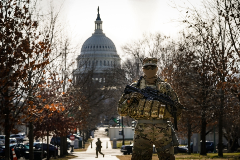 Much of downtown Washington, DC is off-limits behind high fences or cement barricades with storefronts and offices boarded up [John Minchillo/AP Photo]